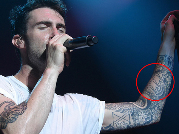 Uncovering adam levine s tattoo what these inks mean oh for Adam levines tattoos